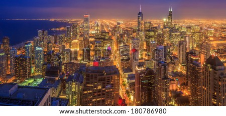 Chicago skyline panorama aerial view with skyscrapers over Lake Michigan at dusk. - stock photo
