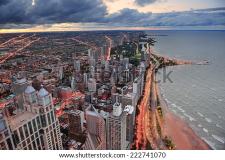 Chicago skyline panorama aerial view with skyscrapers over Lake Michigan with cloudy  sky at sunset. - stock photo