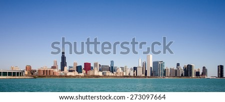 Chicago Skyline - panorama captured on a sunny spring morning showcasing the city's skyscrapers and varied architectural styles.  Room for your copy in the clear blue sky if needed. - stock photo