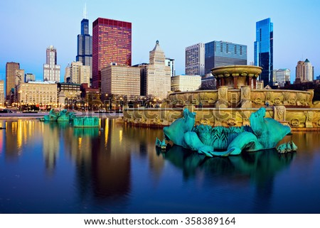 Chicago skyline reflected in Buckingham Fountain. Chicago, Illinois, USA. - stock photo