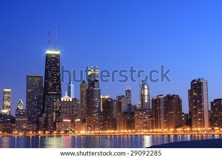 Chicago skyline viewed from North Avenue beach at dusk - stock photo