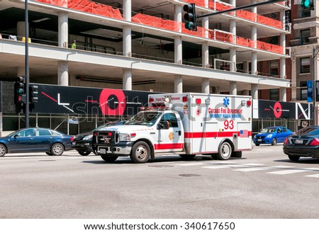 CHICAGO, UNITED STATES - AUGUST 25, 2014: Ambulance of Chicago Fire Department on the road. - stock photo
