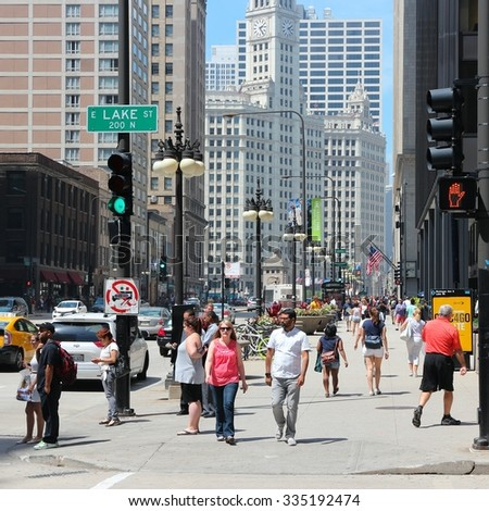 CHICAGO, UNITED STATES - JUNE 27, 2013: People walk downtown in Chicago. Chicago is the 3rd most populous US city with 2.7 million residents (8.7 million in its urban area).