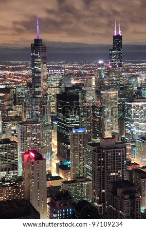 Chicago urban skyline panorama aerial view with skyscrapers and cloudy sky at dusk with lights. - stock photo