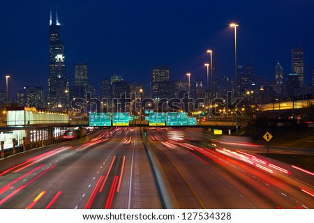 Chicago urban skyscrapers with traffic at dusk, IL, USA - stock photo