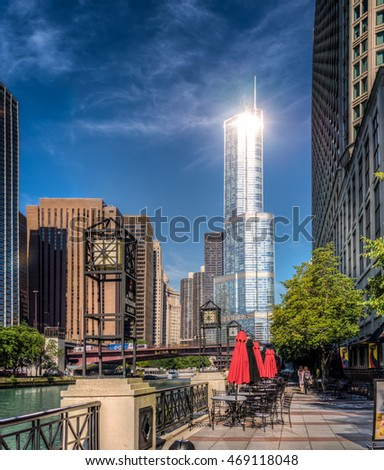 Chicago, US - July 19, 2016: Intense morning sun reflection from Trump Tower. View from river walk, Downtown Chicago