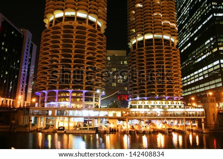 CHICAGO, USA- APR 03: Marina Towers, aka twin corn towers built in 1964, located on north bank of Chicago River at night on April 03, 2008 in Chicago, USA. Here has18 stories of parking space. - stock photo