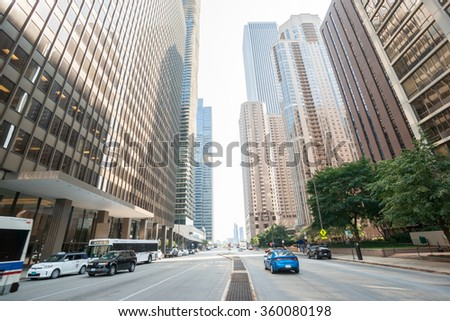 CHICAGO, USA - AUGUST 28: Architecture and street scene along the canyon-like Michigan Avenue known as Cultural Mile USA in light of early morning as city gets going, August 28,2015 in Chicago, USA - stock photo