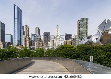 CHICAGO,USA-AUGUST 12,2013:millenium park in Chigago during a sunny day with chicago skyline on background