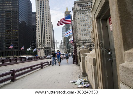 CHICAGO,USA-AUGUST 12,2013:view of Michigan ave with traffic,people and skyline in the center of Chicago during a cloudy day. - stock photo
