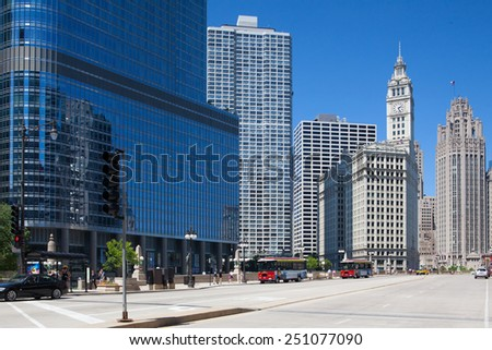 Chicago,USA-July 13,2013: Famous Wrigley building and Trump tower in Chicago.The Wrigley Building is a skyscraper  with two towers (South Tower and North Tower). The Trump Tower was completed in 2008. - stock photo