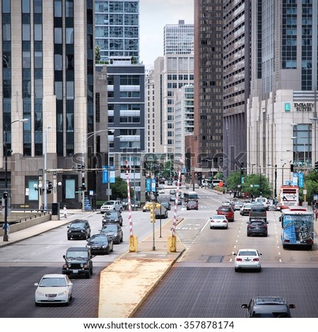 CHICAGO, USA - JUNE 26, 2013: People drive downtown in Chicago. Chicago is the 3rd most populous US city with 2.7 million residents (8.7 million in its urban area).
