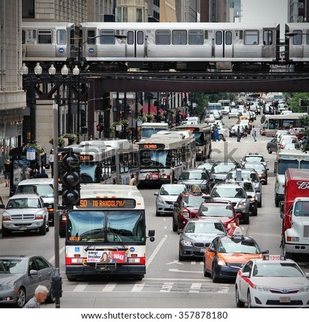 CHICAGO, USA - JUNE 26, 2013: People drive downtown in Chicago. Chicago is the 3rd most populous US city with 2.7 million residents (8.7 million in its urban area). - stock photo