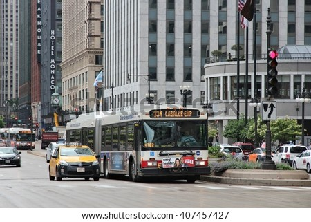 CHICAGO, USA - JUNE 26, 2013: People ride city bus in Chicago. Chicago is the 3rd most populous US city with 2.7 million residents (8.7 million in its urban area).