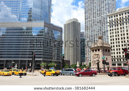 CHICAGO, USA - JUNE 28, 2013: People ride taxi cabs in downtown Chicago. Chicago is the 3rd most populous US city with 2.7 million residents (8.7 million in its urban area).