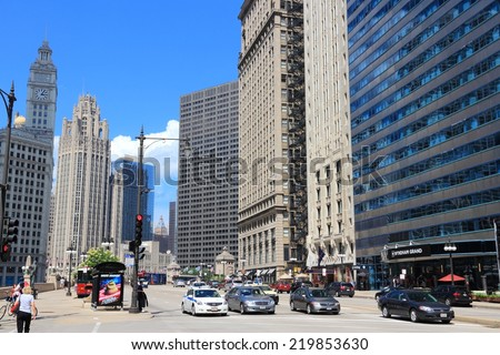 CHICAGO, USA - JUNE 27, 2013: People walk downtown in Chicago. Chicago is the 3rd most populous US city with 2.7 million residents (8.7 million in its urban area). - stock photo