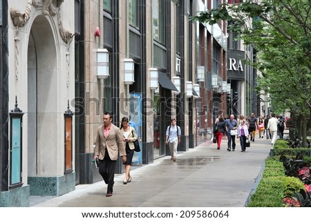 CHICAGO, USA - JUNE 26, 2013: People walk the famous Magnificent Mile of Michigan Avenue in Chicago. It is Chicago's major shopping destination and one of USA's most recognized shopping areas. - stock photo