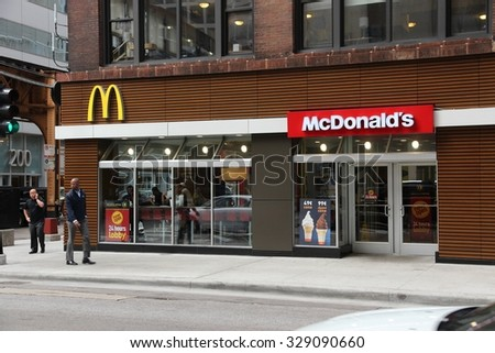 CHICAGO, USA - JUNE 26, 2013: Person walks by McDonald's restaurant in Chicago. McDonald's is the 2nd most successful restaurant franchise in the world with 33,000 locations.