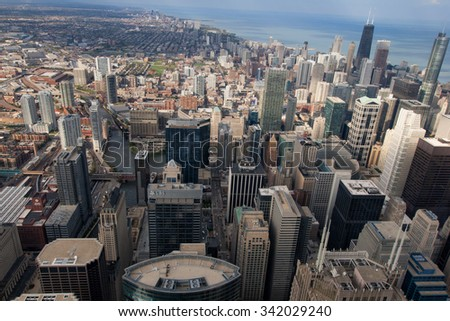CHICAGO, USA - 20 NOVEMBER, 2013: City of Chicago. Aerial view of Chicago downtown at nigh from high above. - stock photo