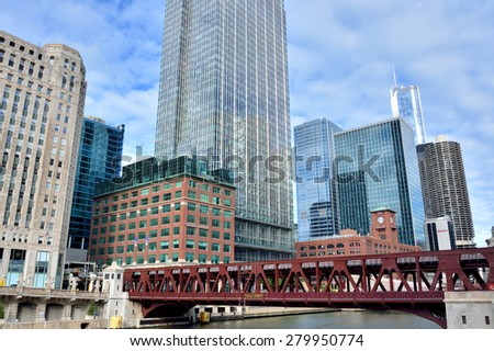 CHICAGO, USA - OCTOBER 6: City modern and historical business buildings beside Chicago river in downtown of Chicago, Illinois, in October 6th, 2014.Chicago is the biggest city in North of USA. - stock photo