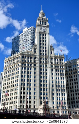 CHICAGO, USA - OCTOBER 6: Famous Wrigley Clock Tower beside Chicago river in downtown of Chicago, Illinois, in October 6th, 2014.Chicago is the biggest city in North of USA