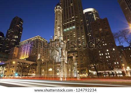Chicago Water Tower. Image of Chicago Water Tower and Michigan Avenue during twilight blue hour. - stock photo