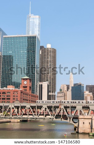 Chicago Waterfront and High Rise Buildings view and metro train going above bridge. Lifestyle series. - stock photo