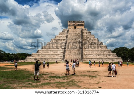 CHICHEN ITZA, MEXICO - AUGUST 2, 2015: Chichen Itza Maya ruins (large pre-Columbian city) is one of the most visited archaeological sites in Mexico. Yucatan, Mexico. - stock photo