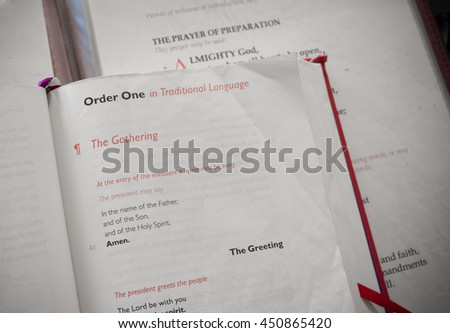 CHICHESTER, ENGLAND - OCTOBER 22, 2015: Prayer book opened at the Hail Mary prayer in the Chichester cathedral - stock photo