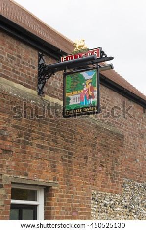 CHICHESTER, ENGLAND - OCTOBER 22, 2015: Traditionally english tavern sign in the old city of Chichester - stock photo