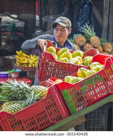 CHICHICASTENANGO , GUATEMALA - JULY 26 : Guatemalan man Sells fruits at the Chichicastenango Market on July 26 2015. This native market is the most colorful in Central America