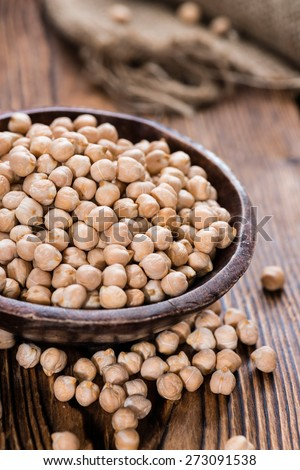 Chick Peas (detailed close-up shot) on vintage wooden background - stock photo