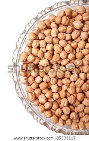 chick peas in a glass plate isolated on white background