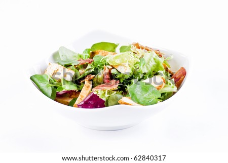 Chicken and bacon with mix of crisp and sweet lettuce leaves - stock photo