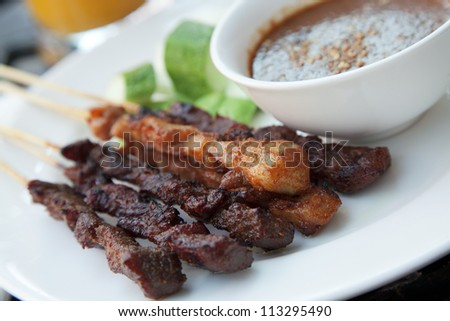 Chicken and beef skewers with satay sauce - stock photo