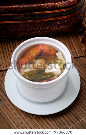 Chicken and herb soup in pot, Chinese food style - stock photo