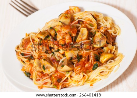 chicken and mushrooms in tomato sauce with spaghetti - stock photo