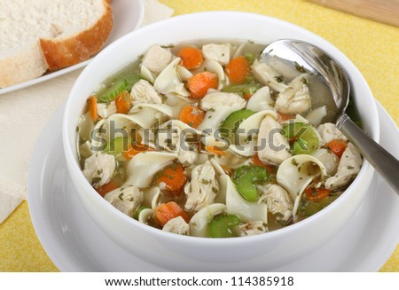 Chicken and noodle soup in a white bowl
