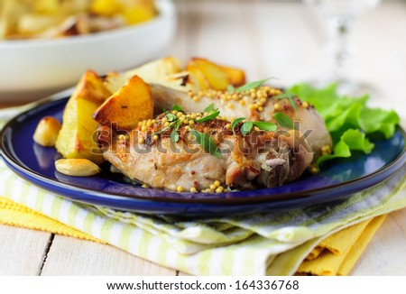 Chicken and Potato Roast with Mustard and Savory - stock photo