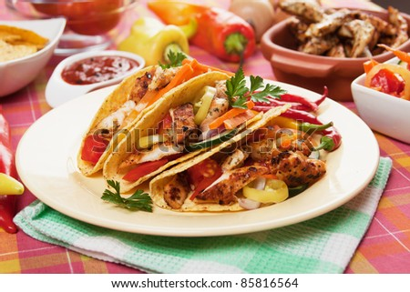 Chicken and vegetable salad served in taco shells - stock photo