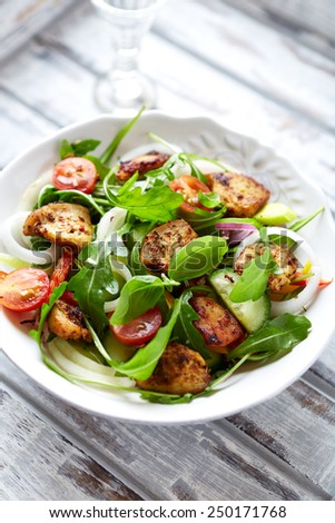 Chicken and vegetable salad with fresh herbs - stock photo