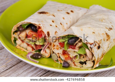 Chicken, Avocado, and Black Beans Burrito in Green Plate