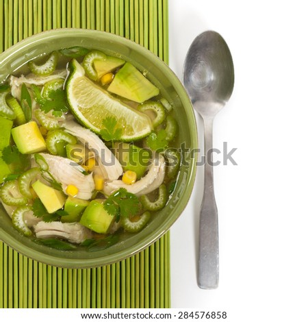 Chicken Avocado Lime Soup on White Background. Selective focus. - stock photo