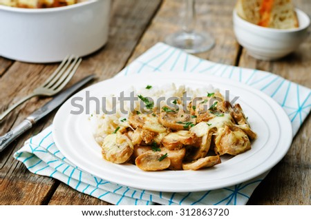 chicken baked with mushrooms and cheese with rice. the toning. selective focus - stock photo