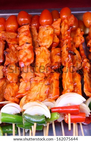 chicken barbecue with sauce and vegetables - stock photo