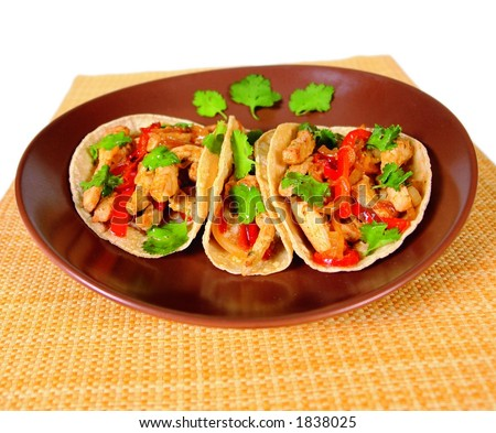 Chicken, beef and vegetable fajitas in tortillas Mexican style