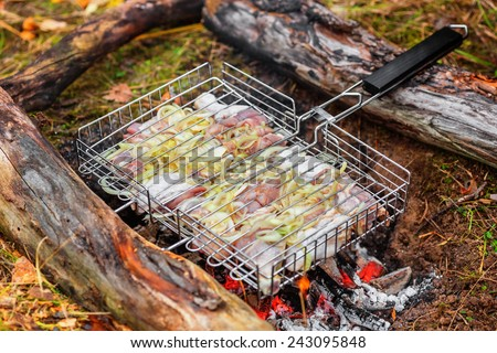 Chicken being roasted over charcoal - stock photo