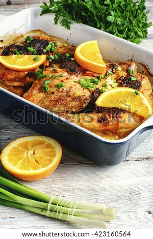 Chicken breast baked with oranges in the oven - stock photo