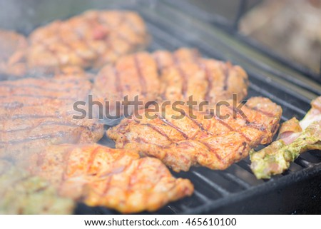 Chicken breast being prepared on grill