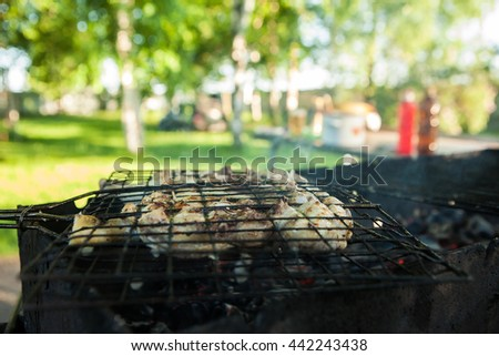 chicken breast grilled with flames. Preparation of meat slices in sauce on fire - stock photo